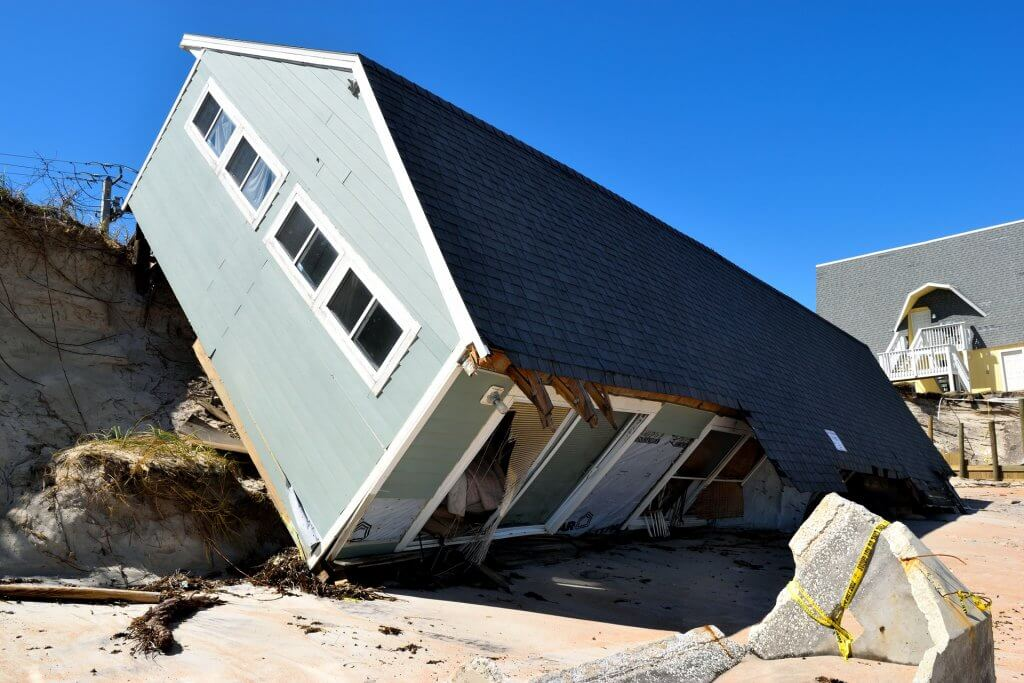 Storm damage to a house showing why landlords insurance is necessary