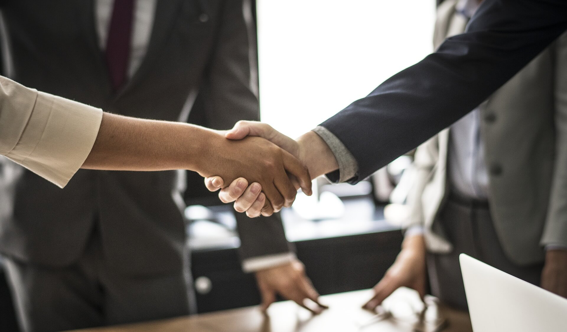 Picture of a handshake after choosing the right agent