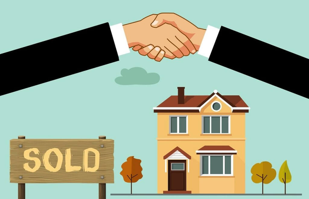 A handshake as a house is sold